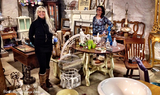 Debby Antonelli and Alison Rose, who operate the popular antique store The Garage, downstairs at BackHome Antiques.