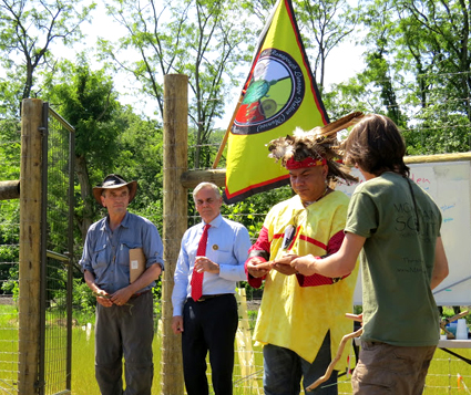 Representative from the Ramapough Lenaape is given a gift from member of the Mohawk nation while Chuck Stead and Chris St. Lawrence look on. / Photo by Geoff Welch