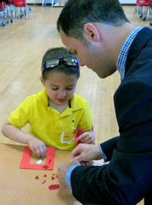 Incoming Sloatsburg Principal Joe Lloyd gave Ryan a hand with at a recent SES kindergarten orientation activity.