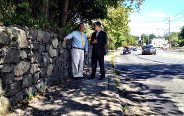Sloatsburg Mayor Carl Wright discusses deteriorating wall along Rt. 17 with Senator David Carlucci.