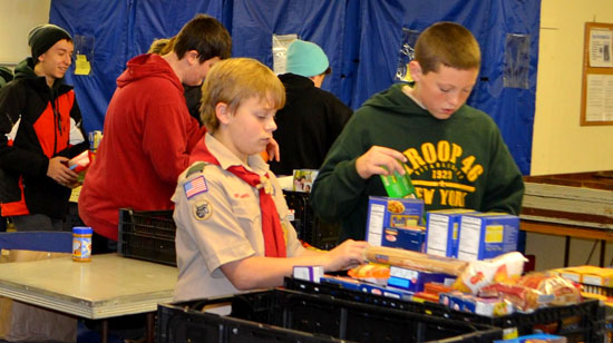 Scouts from Troop 2146  that serves Sloatsburg and Tuxedo sort food from a food drive that collected some 700 pounds for those in need.