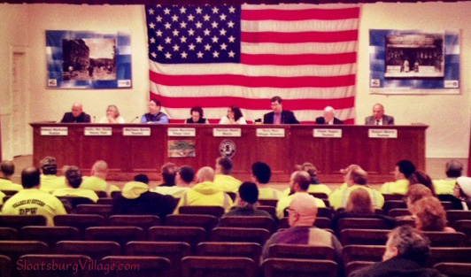 Recent Suffern Village Board meeting with yellow shirts in support of DPW workers.
