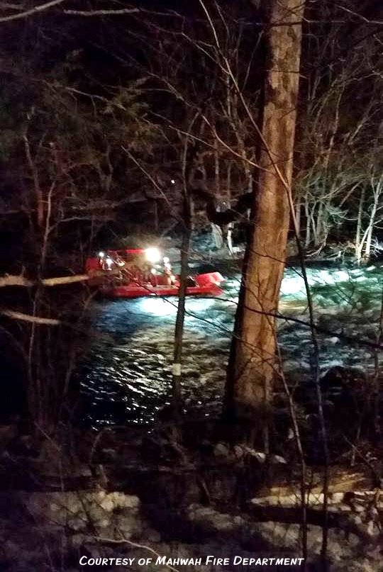Multiple agencies came to the aid of a suspected robber Sunday night, who plunged into the Ramapo River in Sloatsburg and got stranded on a rock.