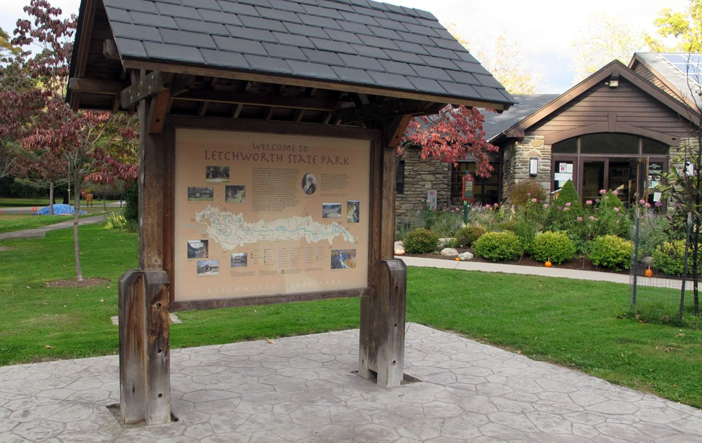 Your basic trailhead kiosk. This one, at Letchworth State Park in central New York State, shows trails, amenities, and pictures of viewpoints. A roof keeps you dry in the rain and a stamped concrete floor keeps your boots from getting muddy. On the opposite side is a description of park wildlife. / Courtesy of MyHarriman.com.