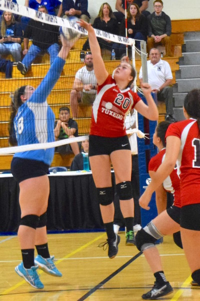 Emily Dowling of the George Baker High School Tornadoes goes up high for a block in recent tournament play. The Lady Tornadoes finished the year with a winning season.