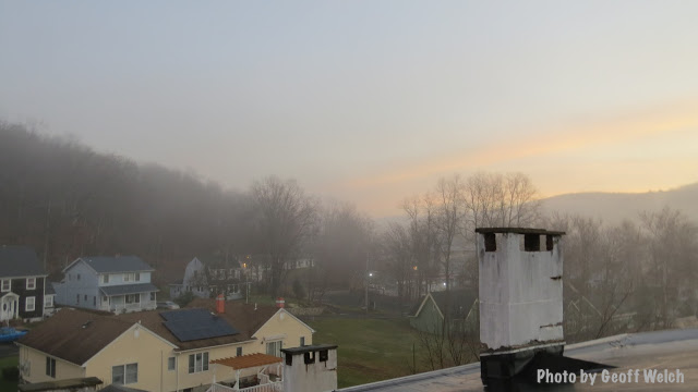 A morning fog tip toes in at sunrise to a just-waking Sloatsburg.