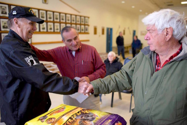 Sloatsburg Mayor Carl Wright (middle) greets Richard Jarcho (right) and a local veteran at one of the recent Sloatsburg Veteran Food Baskets.