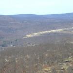 Tuxedo Farms Is Digging Away On The Far Mountain Top