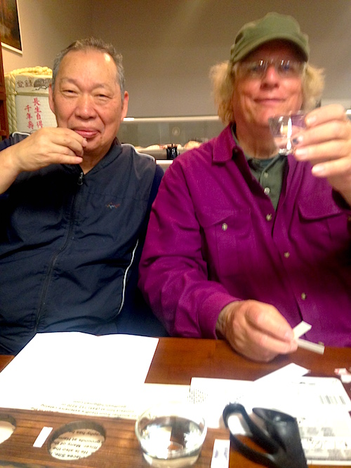 Sushi Ville owner CJ and Geoff Welch toast to a job well done. / Photo by Kathy Goldman